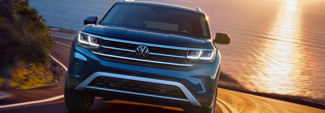 2021 VW Atlas driving on waterfront road