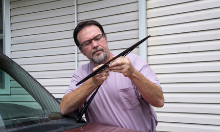 Man holds wipers