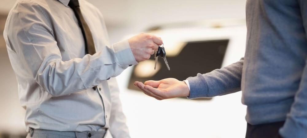 Man gives keys to dealer