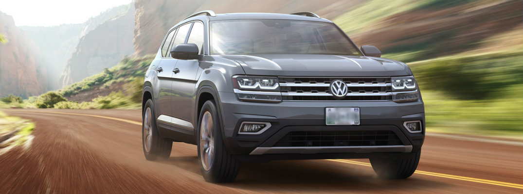 Gray 2018 Volkswagen Atlas cruising on a rural road