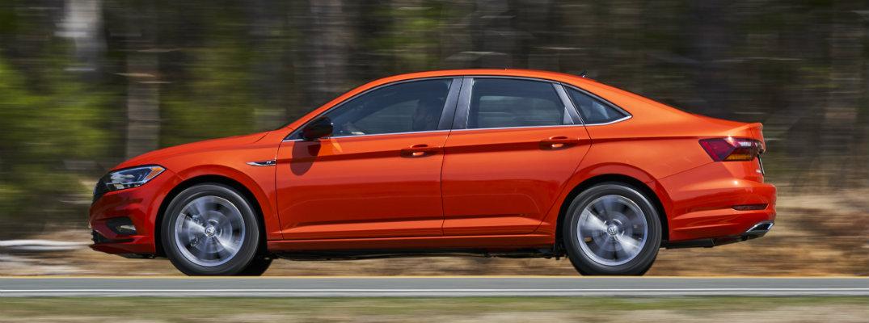 Side profile of orange 2019 Volkswagen Jetta