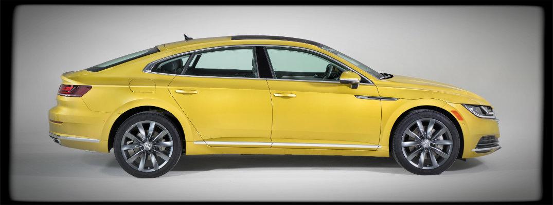 Side profile of yellow 2019 VW Arteon