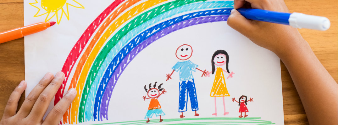 Marker drawing of a family under a rainbow