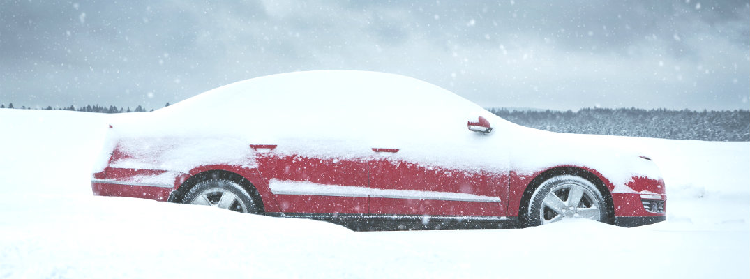 car parked in the snow in winter