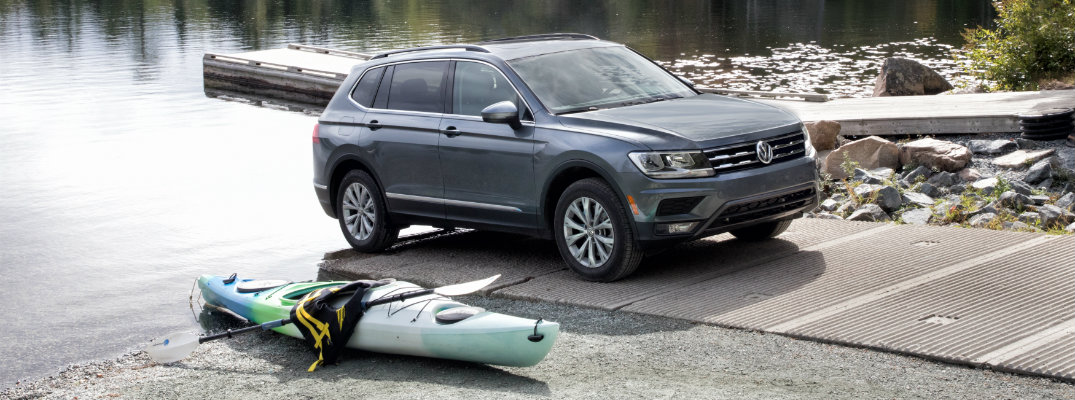 2019 VW Tiguan with a kayak at its side by the water