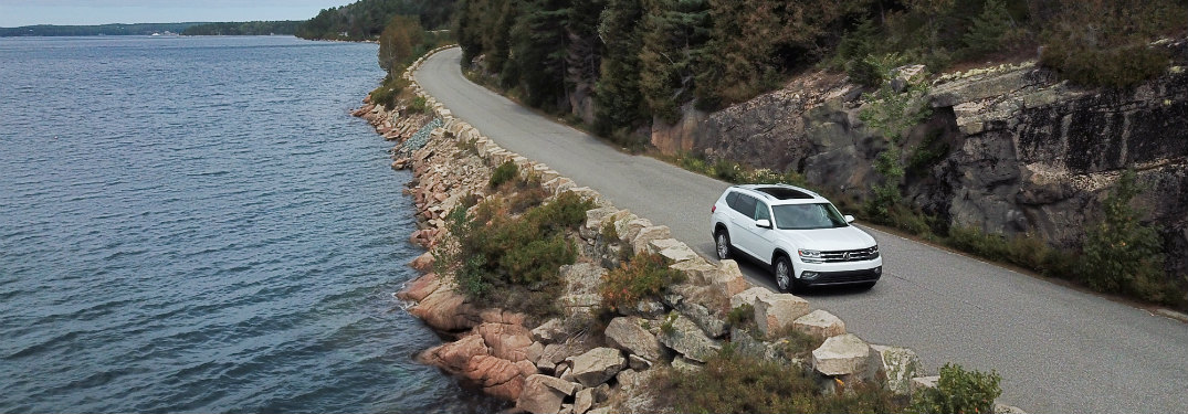 2018 VW Atlas driving on a coastal road in Maine