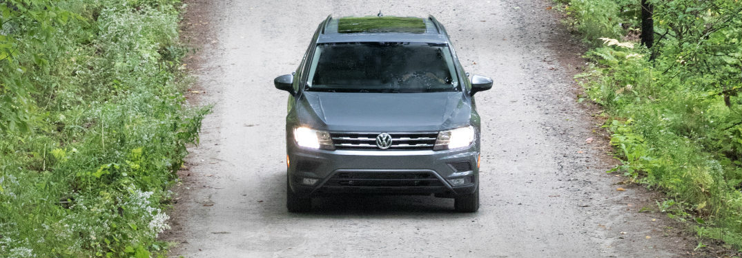 2018 Volkswagen Tiguan driving on a path in the woods