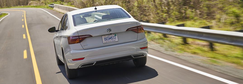 2019 Volkswagen Jetta driving down an empty country highway