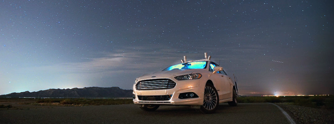 self-driving Ford Fusion at night