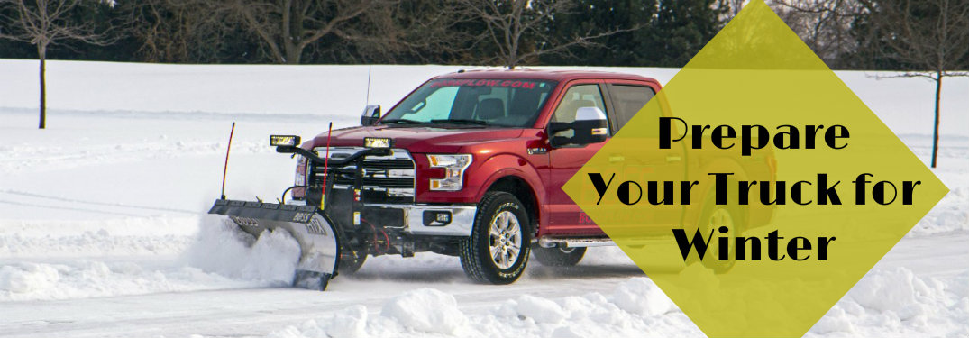 red Ford F-150 driving through snow equipped with a Boss snow plow