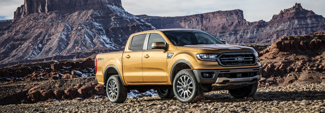 2019 Ford Ranger parked in front of mountains on a dirt road