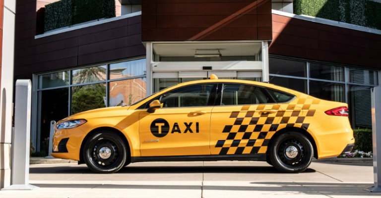 side view of the 2019 Ford Fusion Hybrid Taxi