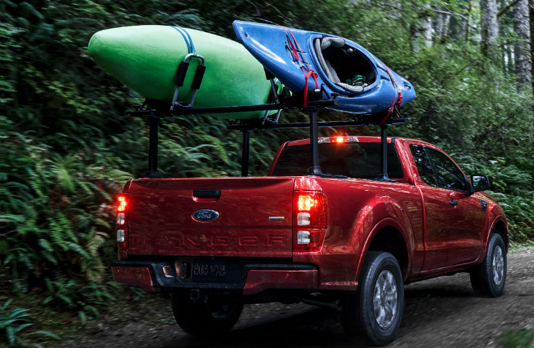 2019 Ford Ranger in the forest carrying kayaks