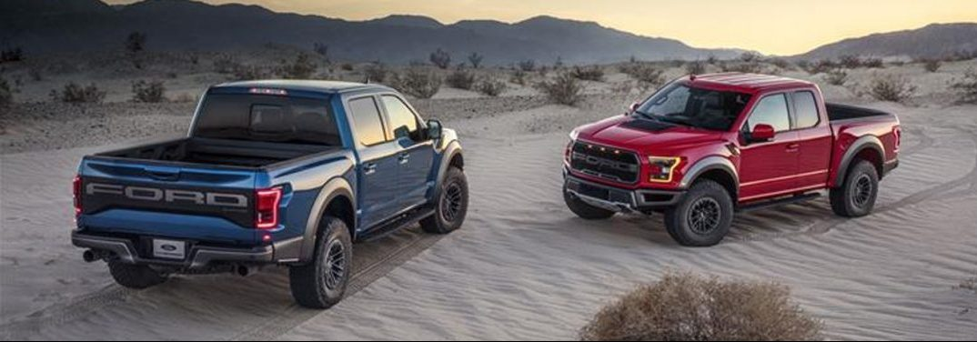 Two different 2019 Ford F-150s face each other in a desert.