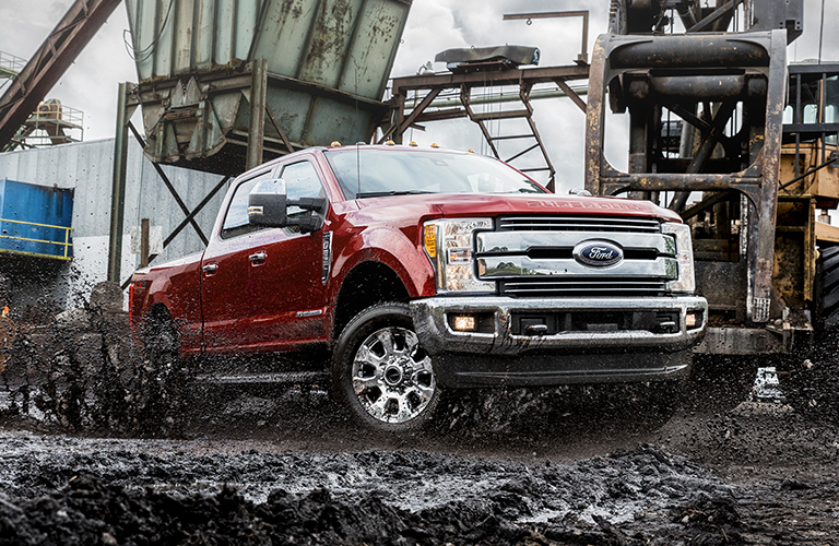 Red 2019 Ford F-250 sits on a construction site looking tough. Exterior angled front/side view.