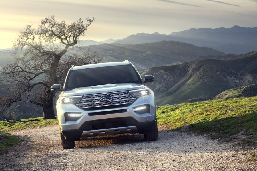 2020 Ford Explorer from exterior front driving on road in front of mountains