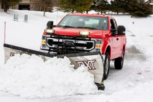 2020 Ford F-Series truck plowing snow