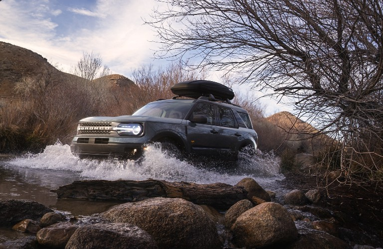 2021 Ford Bronco Sport forging water with roof storage box