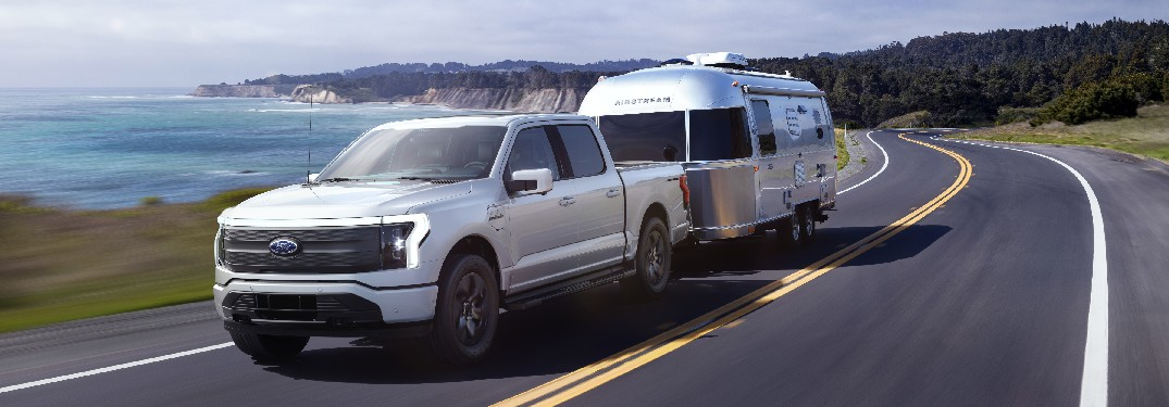 2022 Ford F-150 Lightning towing an Airstream trailer