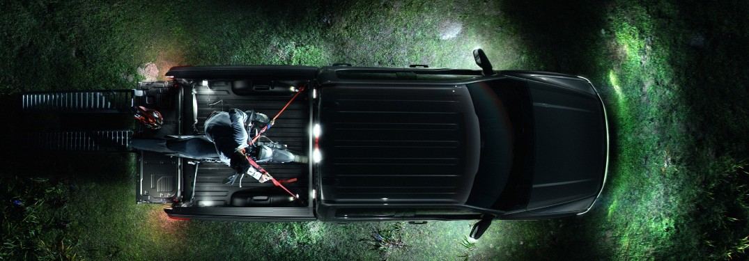 aerial view of a black 2022 Ford F-150 Lightning with all its work lights on