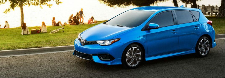 blue 2018 Toyota Corolla iM parked