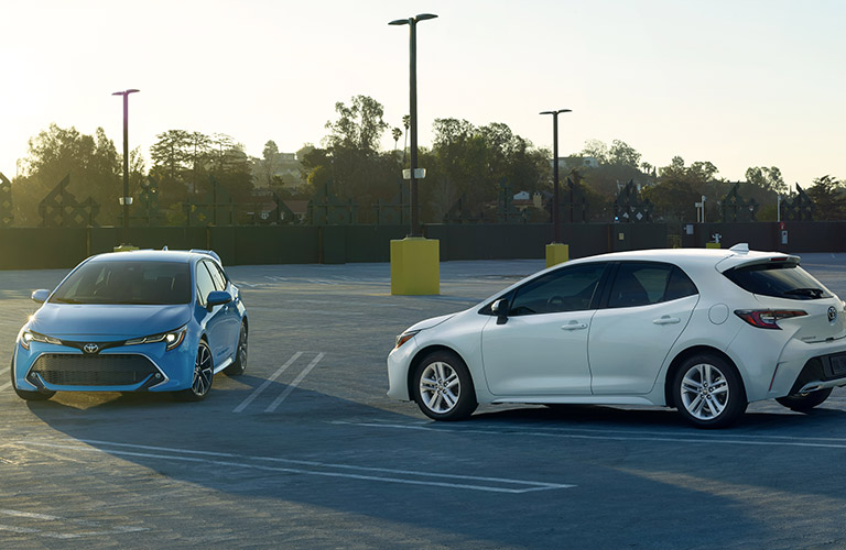 two 2019 Toyota Corolla Hatchback models parked in a parking lot