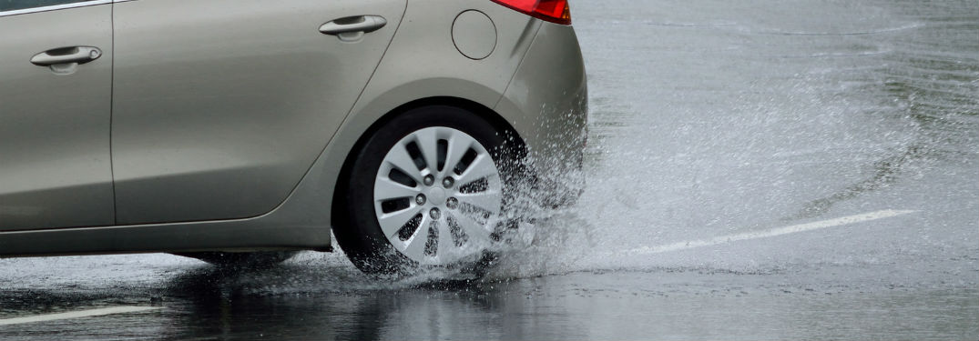 What is hydroplaning? with image of a car hydroplaning while turning