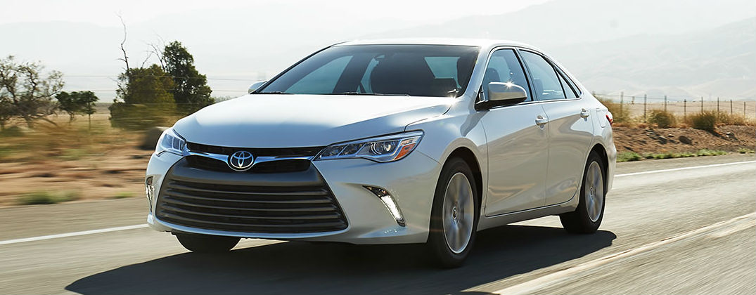 What's New for the 2016 Toyota Camry? at Allan Nott-Lima OH-Fort Wayne IN-New Toyota and Honda Dealer-2016 Toyota Camry White Exterior on Country Road