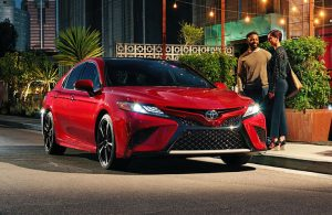 Red 2018 Toyota Camry parked