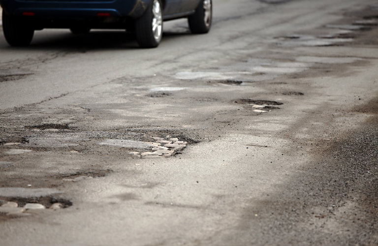 line of potholes in road