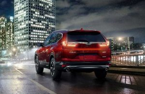 2019 Honda CR-V AWD driving on a wet road at night