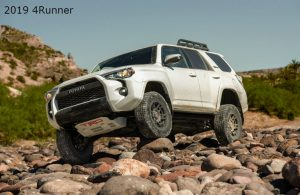 2019 Toyota 4Runner TRD Pro in Super White parked on rocks