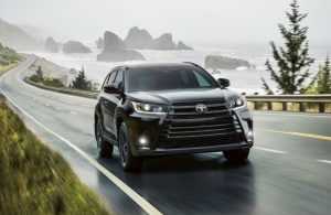 2019 Toyota Highlander driving on a wet road