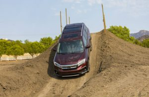2019 Honda Pilot Elite driving down a steep dirt hill