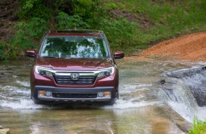 2019 Honda Ridgeline driving through a small creek