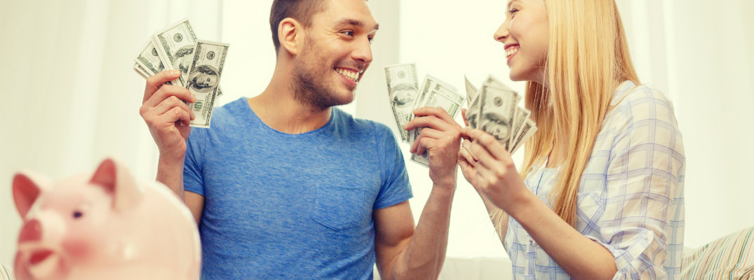 Couple with money from a piggy bank