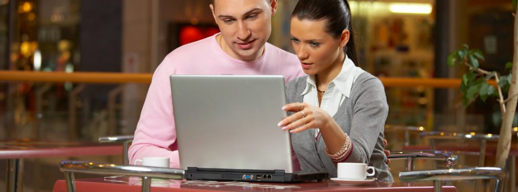 Couple looking at a laptop computer
