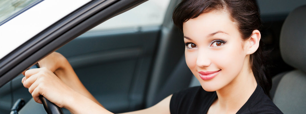 Young woman behind the wheel of a vehicle
