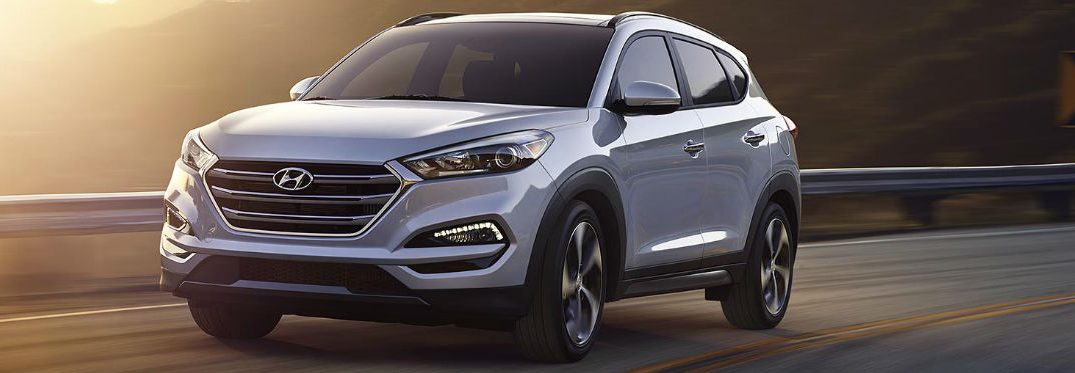 2018 hyundai tucson driving on the highway at sunset