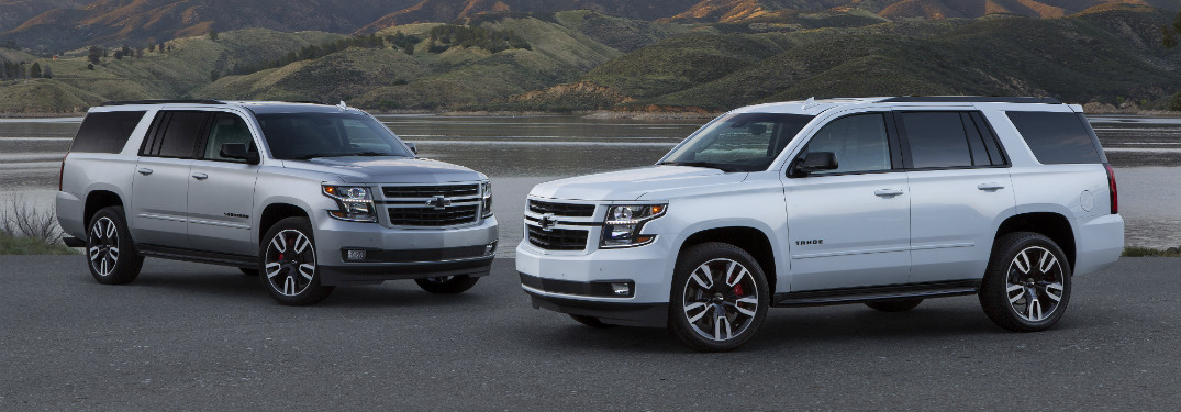 front and side view of silver and white 2019 chevy tahoe