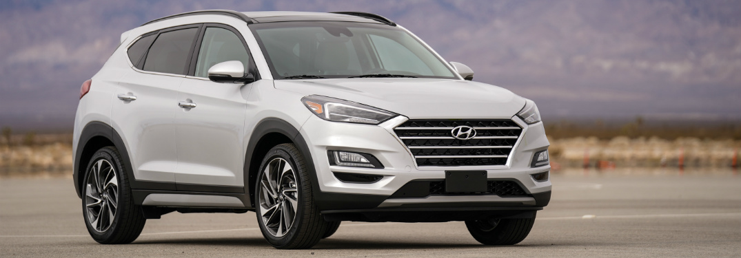 front and side view of silver 2019 hyundai tucson
