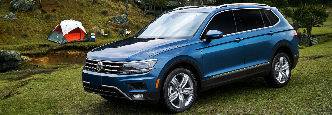 front and side view of blue 2019 volkswagen tiguan
