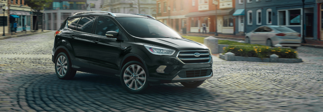 front and side view of black 2019 ford escape