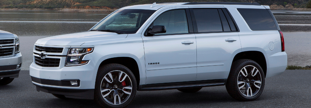 front and side view of white 2019 chevy tahoe