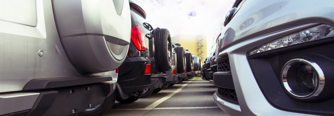 rows of different rear and front bumpers of cars in car lot