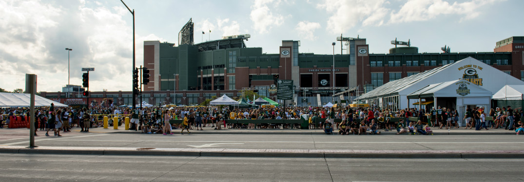 exterior of lambeau field and parking lot with tailgate parties