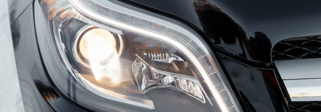 close up of headlight of black car