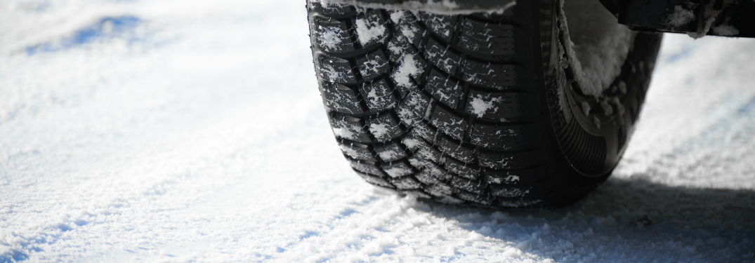 close up of car tire on winter snow road