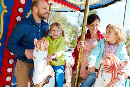 Happy Family on a Carnival Ride