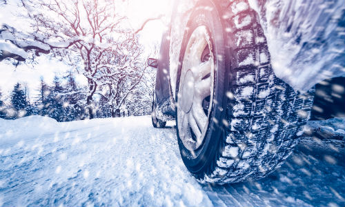 Closeup of car wheel on snow